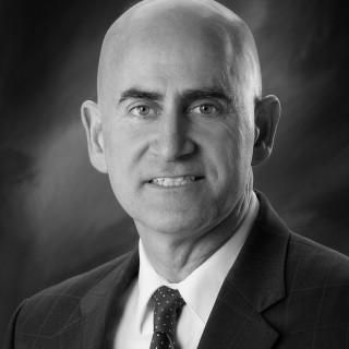 John P. Guzik