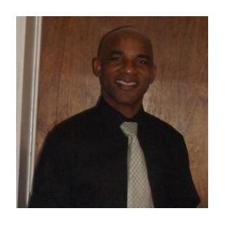 Mr. Travis E. Stroud