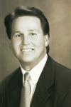 Gregory J White