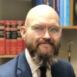 Justin P. Enecks