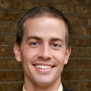 Justin D Caplin