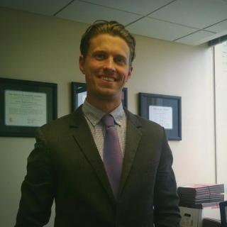 Adam C Neal