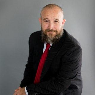 Scott J Schrum