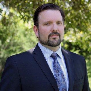 Andrew E Stadler