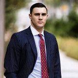 Aaron J Reed