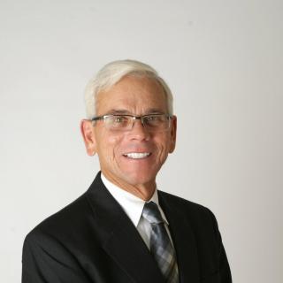 Dennis Tackett Esq
