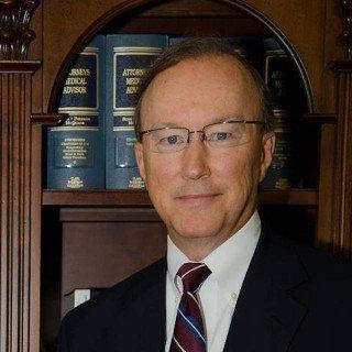 John E. Suthers
